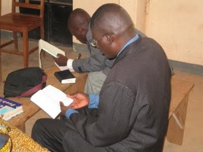 Antoine, one of pastors in training, reading his Bible before graduation
