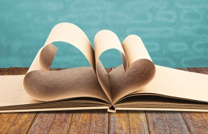 Book with opened pages of shape of heart